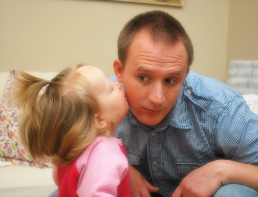 ella kissing daddy