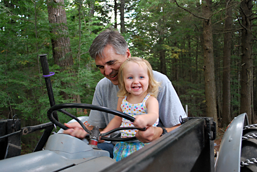 ella and pop pop on the tractor