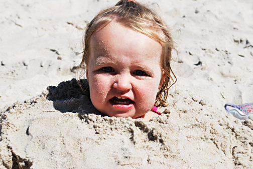ella buried in the sand